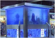 Fabricated stainless steel fish tank with blue tinted glass and cold cathode illumination, Heathrow Airport.