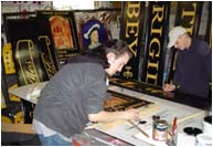 Traditional signwriting in the signwriting department